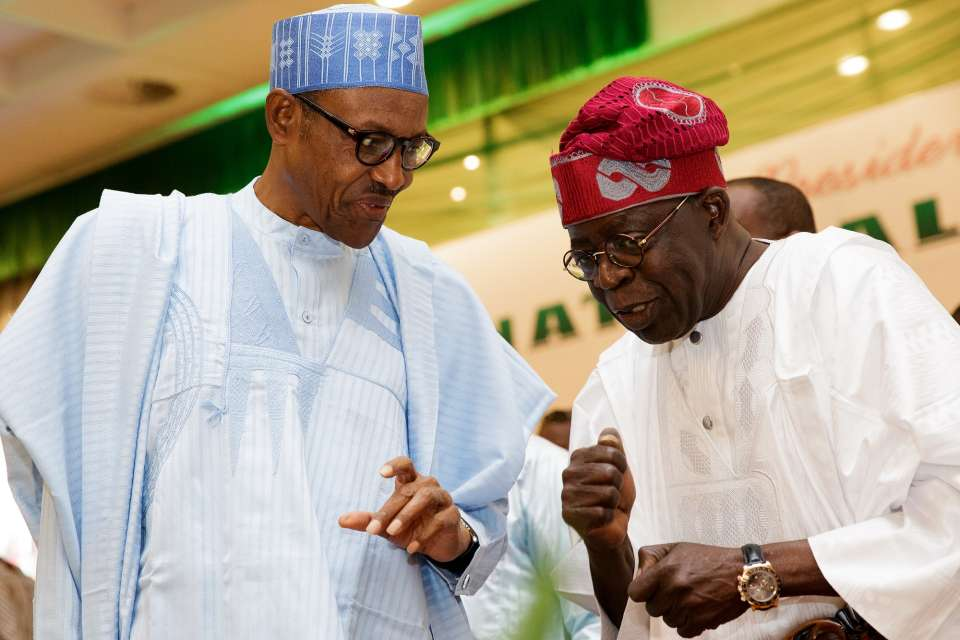President-Buhari-chats-with-APC-chieftain-Asiwaju-Bola-Ahmed-Tinubu-at-a-Presidential-Dinner-in-honour-of-members-of-the-National-Assembly
