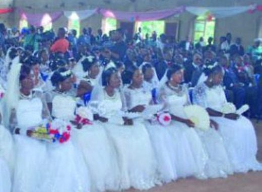 Popular Catholic priest Sponsors Wedding Of 117 Couples In One Day